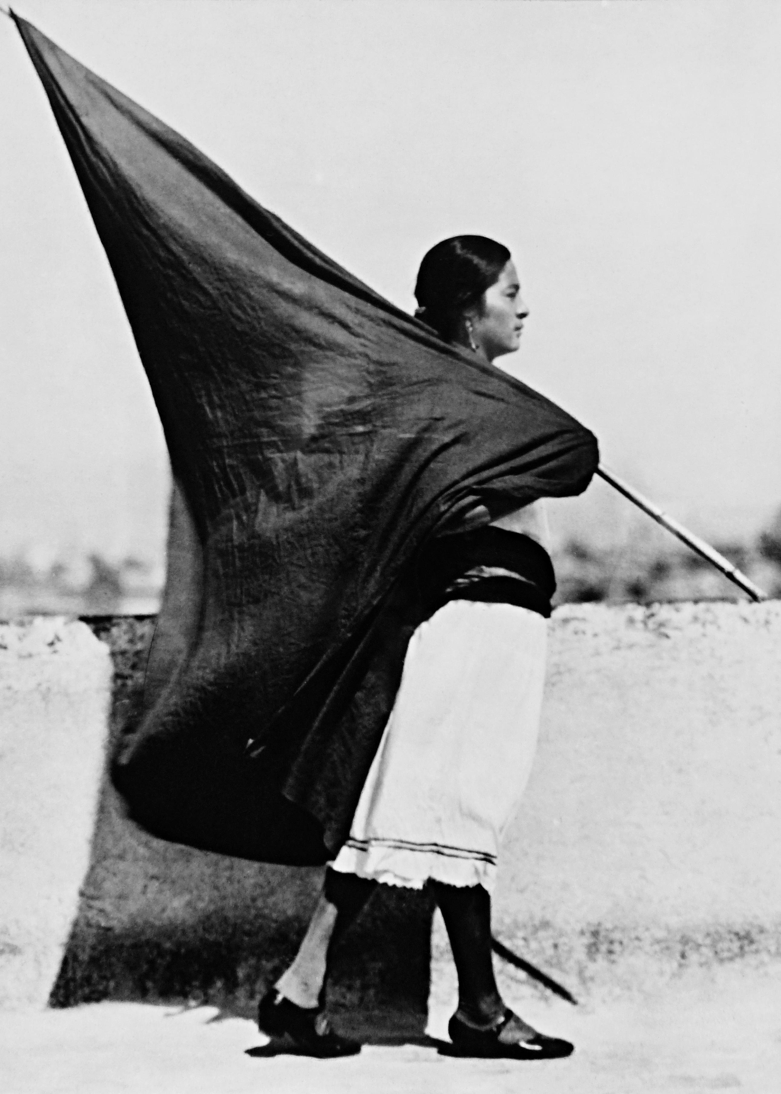 Tina Modotti, Woman with Flag,  Mexico, 1928, silver gelatin print, modern print, 8.6 × 6.3 in.